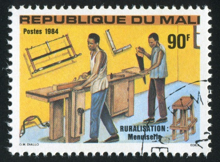 MALI CIRCA 1984: stamp printed by Mali, shows Carpenters, circa 1984 photo