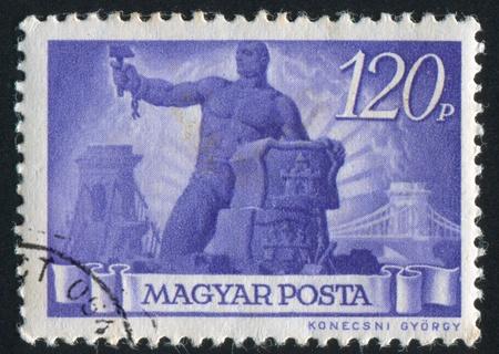 HUNGARY - CIRCA 1945: stamp printed by Hungary, shows worker, circa 1945 photo