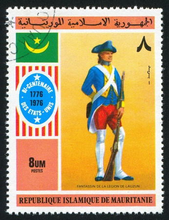 vintage riffle: MAURITANIA - CIRCA 1976: stamp printed by Mauritania, shows French Legion Infantryman, circa 1976