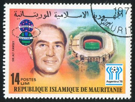 alf: MAURITANIA - CIRCA 1977: stamp printed by Mauritania, shows Emblem, Alf Ramsey and stadium, circa 1977