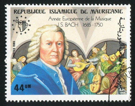 making music: MAURITANIA - CIRCA 1985: stamp printed by Mauritania, shows Bach and painting, Angels Making Music, circa 1985 Editorial