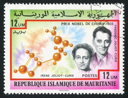 frederic: MAURITANIA - CIRCA 1977: stamp printed by Mauritania, shows Irene and Frederic Joliot-Curie, circa 1977 Editorial