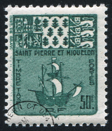 ST. PIERRE AND MIQUELON - CIRCA 1947: stamp printed by Saint Pierre and Miquelon, shows Arms and Fishing Schooner, circa 1947. photo