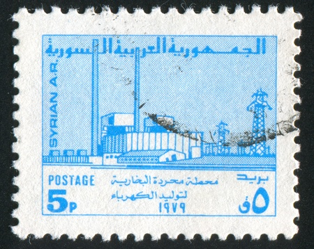 SYRIA - CIRCA 1979: stamp printed by Syria, shows factory and power station, circa 1979. photo