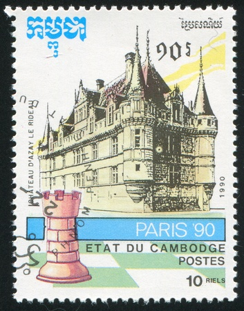 CAMBODIA - CIRCA 1990: stamp printed by Cambodia, shows Chess piece and Chateau, circa 1990 photo