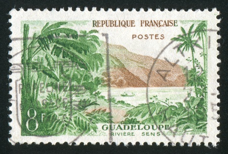 sens: FRANCE - CIRCA 1957: stamp printed by France, shows Sens river, Guadeloupe, circa 1957 Stock Photo