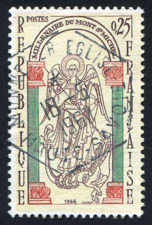 slaying: FRANCE - CIRCA 1966: stamp printed by France, shows Saint-Michael slaying dragon, circa 1966