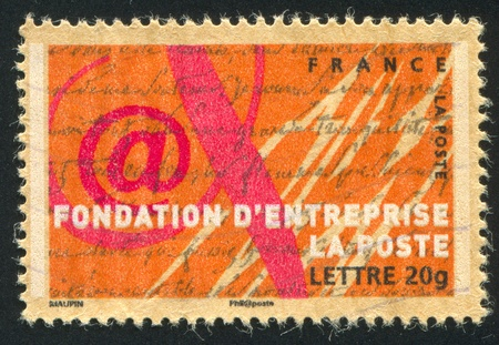 FRANCE - CIRCA 2006: stamp printed by France, shows Emblem of Post Business Foundation, circa 2006 photo