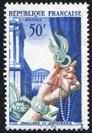 FRANCE - CIRCA 1954: stamp printed by France, shows jewelry and metalsmith's work, circa 1954 photo