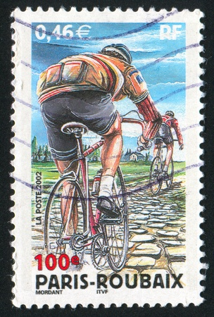 FRANCE - CIRCA 2002: stamp printed by France, shows Paris-Roubaix Bicycle Race , circa 2002 photo