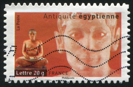 scribe: FRANCE - CIRCA 2007: stamp printed by France, shows Egyptian Statue of Seated Scribe, circa 2007