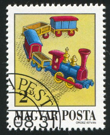HUNGARY - CIRCA 1988: stamp printed by Hungary, shows Train, Antique Toy, circa 1988 photo