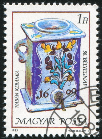 faience: HUNGARY - CIRCA 1985: stamp printed by Hungary, shows Faience water jar and dispenser, 1609, circa 1985 Stock Photo