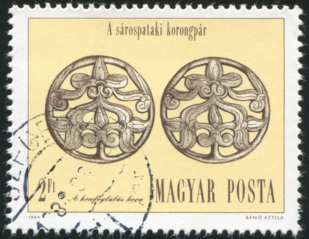 HUNGARY - CIRCA 1984: stamp printed by Hungary, shows Silver Disc Hair Ornaments of Sarospatak, circa 1984 Stock Photo - 12118725