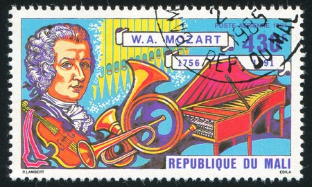 MALI - CIRCA 1981: stamp printed by Mali, shows Mozart and instruments, circa 1981 Stock Photo - 12117048