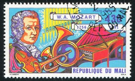 MALI - CIRCA 1981: stamp printed by Mali, shows Mozart and instruments, circa 1981 Stock Photo - 12117048