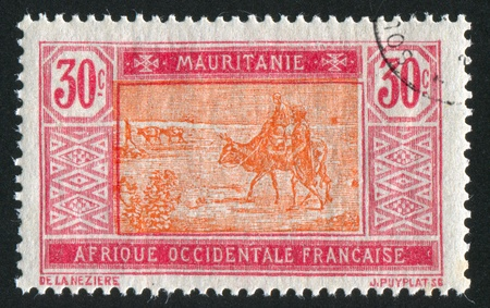 MAURITANIA - CIRCA 1922: stamp printed by Mauritania, shows Bedouins and animals, circa 1922 photo