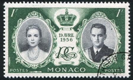 MONACO - CIRCA 1956: stamp printed by Monaco, shows Princess Grace and Prince Rainier III, circa 1956