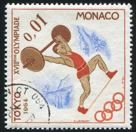 weight lifter: MONACO - CIRCA 1964: stamp printed by Monaco, shows Weight Lifter, circa 1964