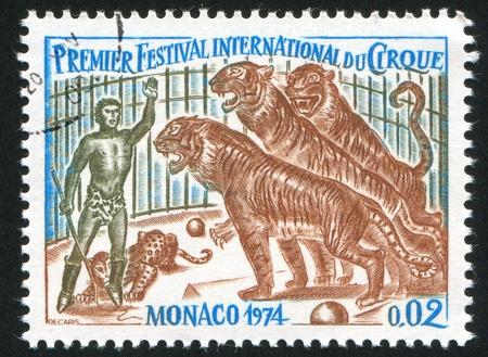 raptorial: MONACO - CIRCA 1974: stamp printed by Monaco, shows Trainer and Tigers, circa 1974
