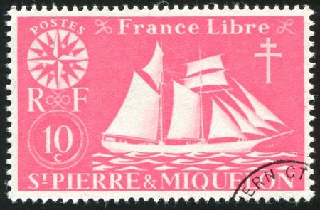 st malo: ST. PIERRE AND MIQUELON - CIRCA 1942: stamp printed by Saint Pierre and Miquelon, shows St. Malo Fishing Schooner, circa 1942. Stock Photo