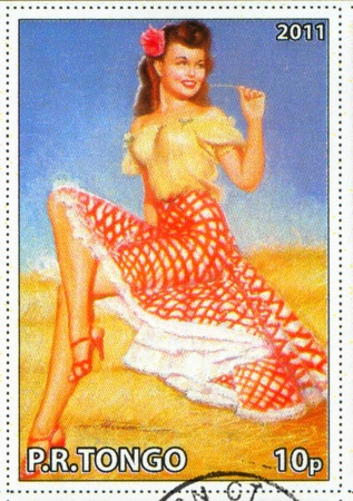earl: TONGO - CIRCA 2011: stamp printed by Tongo, shows Pin-up girl, by Earl MacPherson, circa 2011 Editorial