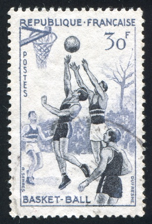 FRANCE - CIRCA 1956: stamp printed by France, shows basketball players, circa 1956 photo