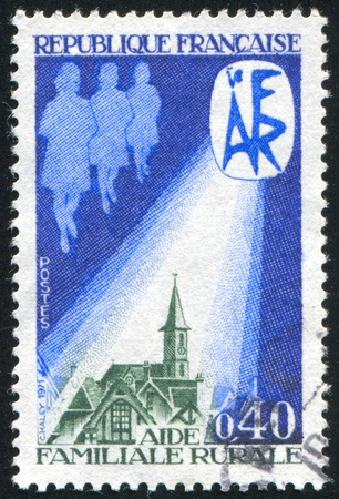 FRANCE - CIRCA 1971: stamp printed by France, shows Rural family help, Shedding Light Village, circa 1971 photo