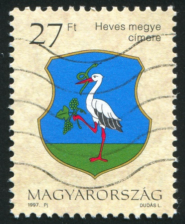 HUNGARY - CIRCA 1997: stamp printed by Hungary, shows Coat of Arms of Heves, circa 1997 photo