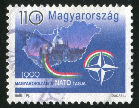 HUNGARY - CIRCA 1999: stamp printed by Hungary, shows Hungary Entering into NATO, circa 1999 photo