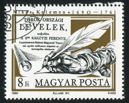 HUNGARY - CIRCA 1990: stamp printed by Hungary, shows Hand of Kelemen Mikes with Pen Writing on the Paper, circa 1990 Stock Photo - 12384208