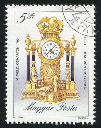 HUNGARY - CIRCA 1990: stamp printed by Hungary, shows Antique Clock, circa 1990 photo