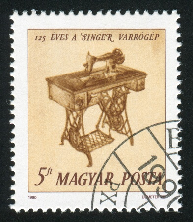 stitching machine: HUNGARY - CIRCA 1990: stamp printed by Hungary, shows Singer Sewing Machine, circa 1990 Stock Photo