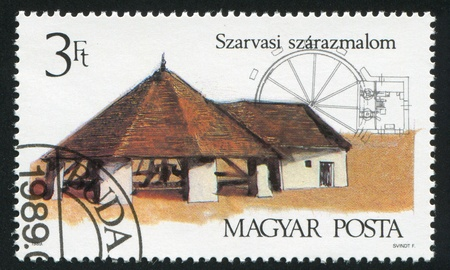 HUNGARY - CIRCA 1989: stamp printed by Hungary, shows Horse-Driven Mill in Szarvas, circa 1989 photo
