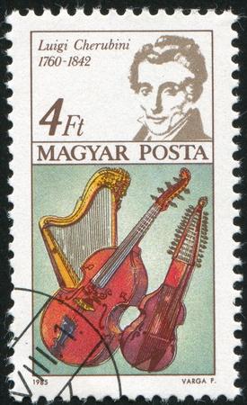 bowed head: HUNGARY - CIRCA 1985: stamp printed by Hungary, shows Luigi Cherubini, Harp, Bass Viol and Baryton, circa 1985