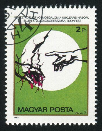 harmed: HUNGARY - CIRCA 1985: stamp printed by Hungary, shows Illustration of a Damaged Globe and Hands by Imre Varga, circa 1985 Stock Photo