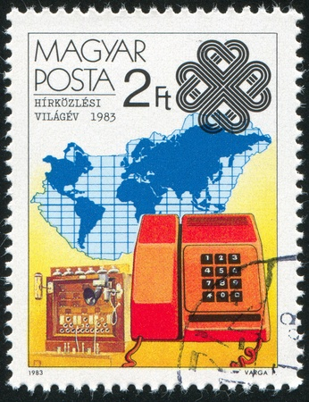 HUNGARY - CIRCA 1983: stamp printed by Hungary, shows TMM-81 Telephone Service and Map, circa 1983 Reklamní fotografie