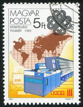 HUNGARY - CIRCA 1983: stamp printed by Hungary, shows Intelligent Terminal System and Map, circa 1983 photo