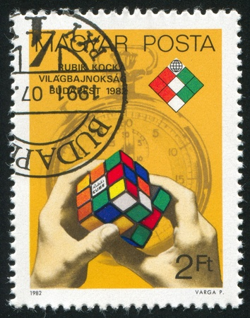 HUNGARY - CIRCA 1982: stamp printed by Hungary, shows Rubiks Cube and Stop Watch, circa 1982