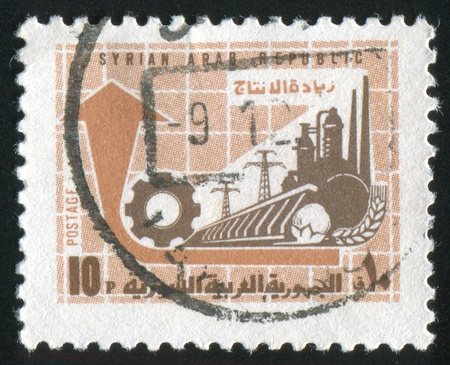 SYRIA - CIRCA 1970: stamp printed by Syria, shows factory and power station, circa 1970. photo