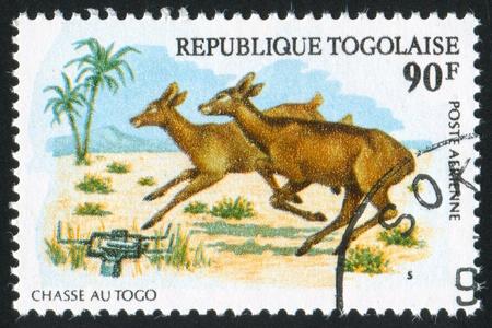 TOGO - CIRCA 1975: stamp printed by Togo, shows Running deer, circa 1975 photo