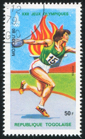 TOGO - CIRCA 1979: stamp printed by Togo, shows Olympic Emblems and Discus, circa 1979 Stock Photo - 12384268