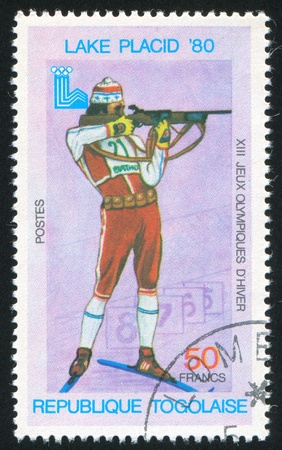 backsight: TOGO - CIRCA 1980: stamp printed by Togo, shows Biathlon, Lake Placid, circa 1980