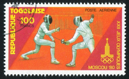 olympic symbol: TOGO - CIRCA 1980: stamp printed by Togo, shows Fencing, circa 1980