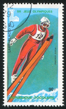 TOGO - CIRCA 1980: stamp printed by Togo, shows Olympic Emblems and Ski Jump, circa 1980