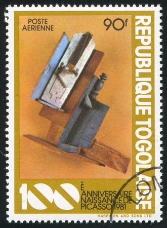 TOGO - CIRCA 1981: stamp printed by Togo, shows Violin and Bottle on table, Picasso, circa 1981