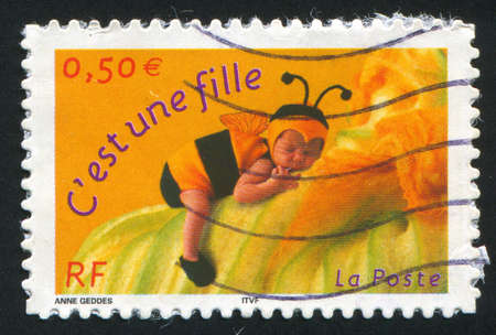 FRANCE - CIRCA 2001: stamp printed by France, shows girl-bumblebee, circa 2001