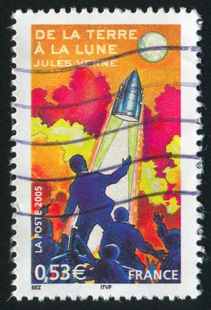 FRANCE - CIRCA 2005: stamp printed by France, shows from the Earth to the Moon, circa 2005 photo