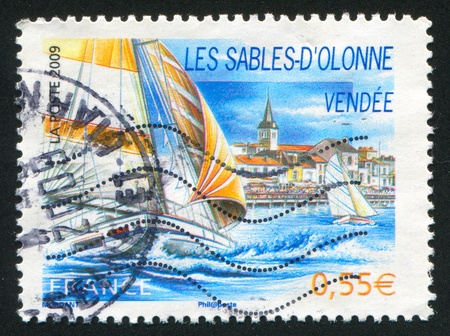 FRANCE - CIRCA 2009: stamp printed by France, shows Les Sables d'Olonne and boat, circa 2009 Stock Photo - 12395587