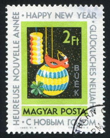HUNGARY  CIRCA 1963: stamp printed by Hungary, shows lanterns, mask and clover, circa 1963 photo